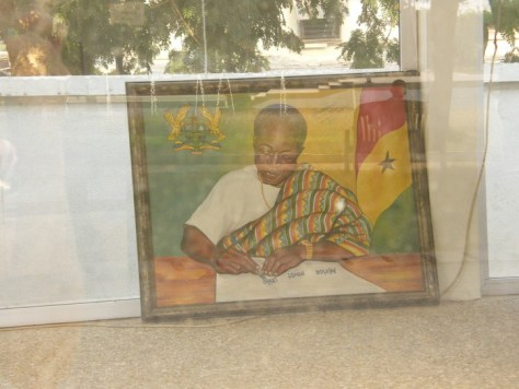 A photo of Kwame Nkrumah with the African flag beside him
