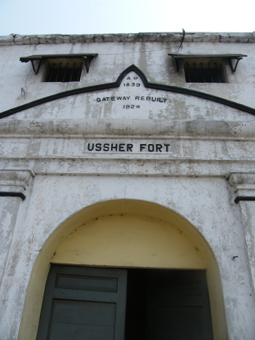 """A close-up of the name """"Ussher Fort"""" engrave above the interior entrance says, """"A.D. 1839, Gateway rebuilt 1924, Ussher Fort""""."""