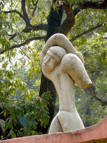 An abstract sculpture of male figure with his head facing backward