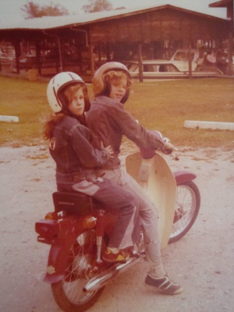 Jon and Angélique riding a moped
