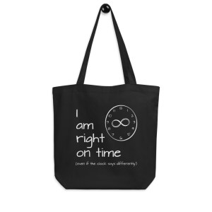 """""""I am Right on Time"""" affirmation artwork eco tote bag front hanging from hanger"""