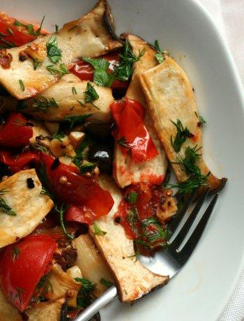 Warm mushrooms salad with tomatoes and garlic dressingWarm mushrooms salad with tomatoes and garlic dressing