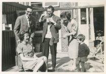 """""""Eind april 1960. Saskia = 9 maanden, Andrea = 3 jaar. We vieren 't afscheid van Anke + Berry."""""""