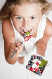 girl eating yogurt iStock_000017575748Large