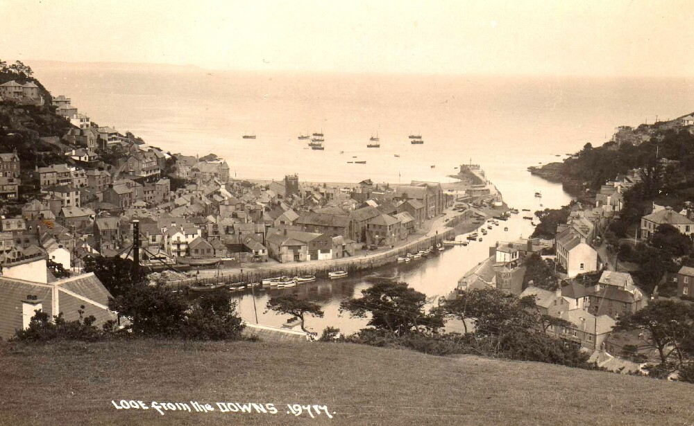 Figure 1. Looe from the Downs, 1908. Here we have a view down river, with St Nicholas Church in the foreground and Hannafore Road going along the harbourside to become Marine Drive on reaching Hannafore