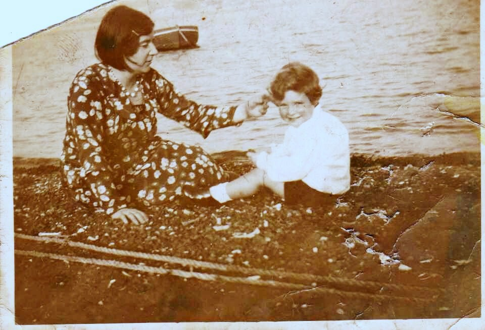 Figure 7. Emma Woodrow Bowden, and son, Tom, on Torpoint Beach in 1932.