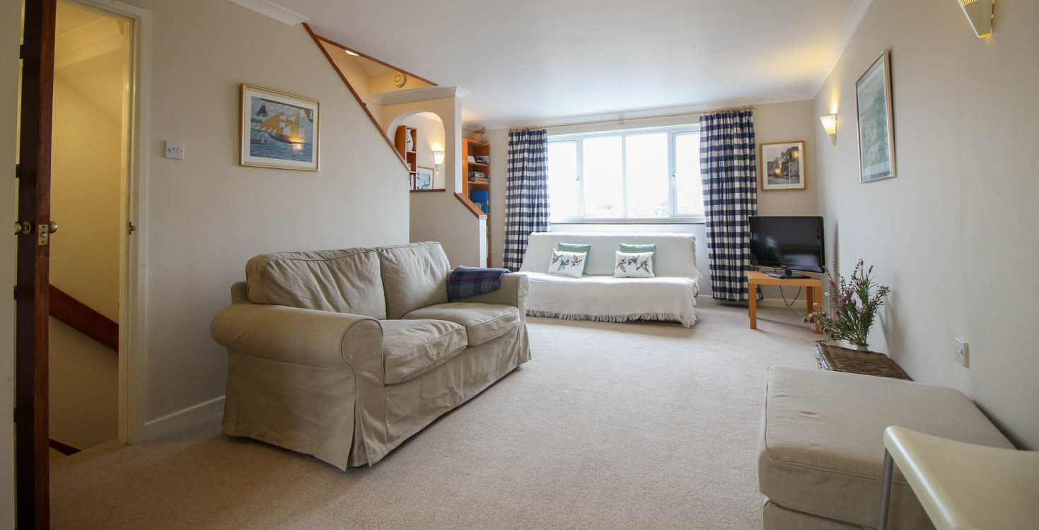 camel and gray living room with navy blue couch cornwall holiday cottages wadebridge view