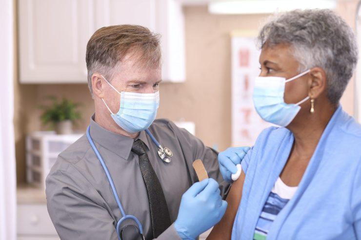 A woman receives a COVID-19 shot.