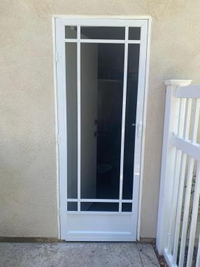White prairie swinging screen door.