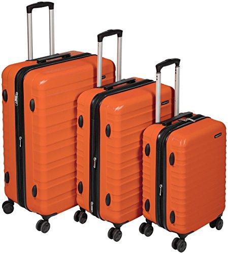 AmazonBasics - Set di trolley rigidi con rotelle girevoli, Set da 3 pezzi (55 cm, 68 cm, 78 cm), Arancione, valigie da viaggio