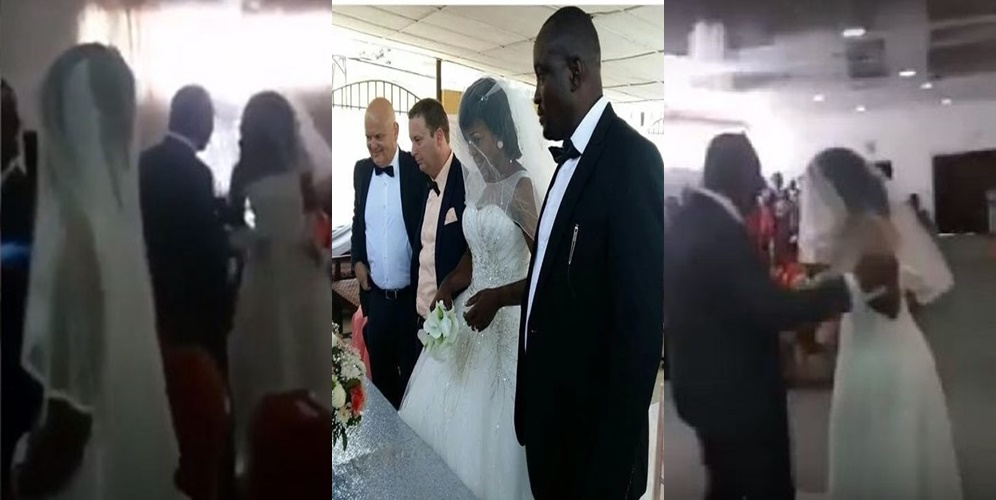 Okokobioko! Angry 'side chick' dressed in bridal gown disrupts wedding ceremony of her lover (Video)