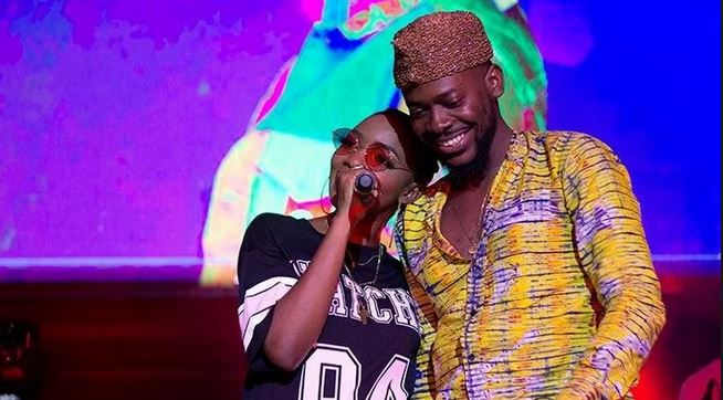 Adekunle Gold replies a follower who vowed to take his wife, Simi from him when he becomes rich