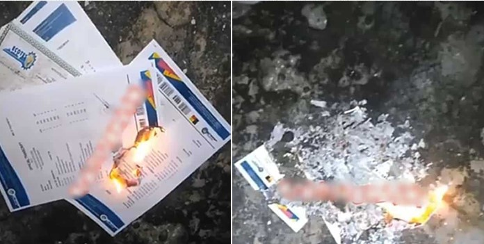 """School na major scam"" – man says as he burns his certificates (Video)"