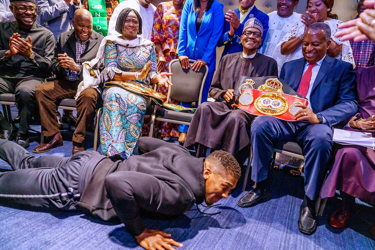 Anthony Joshua prostrates for President Buhari, show him heavyweight titles (VIDEO)