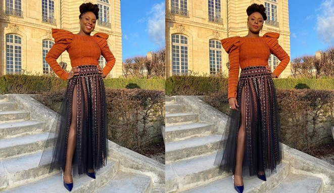 Photos: Chimamanda Ngozi-Adichie shows some skin as she displays her leg in crotch-high skirt
