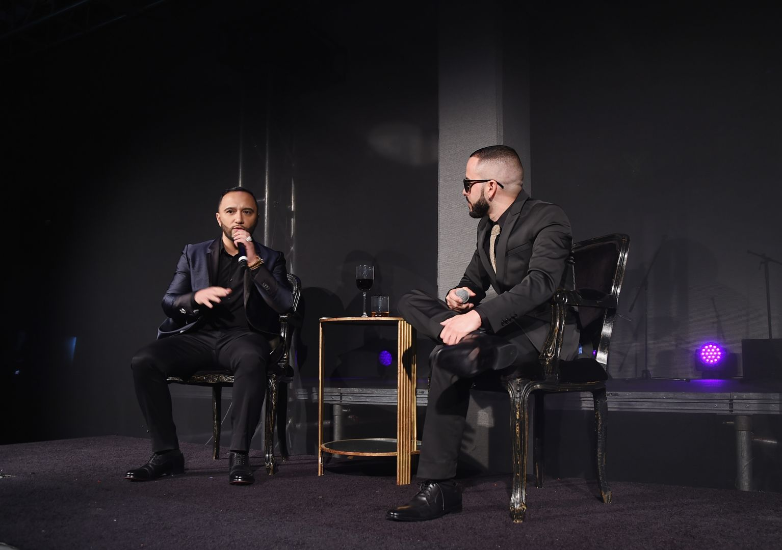 """Alex Sensation (L) and musician Yandel take part in a Q&A during the HBO Latino red carpet premiere of the """"Camino Al Concierto and Legacy: De Lider a Leyenda"""" at Center 548 on April 7, 2015 in New York City. (Photo by Michael Loccisano/Getty Images for HBO)"""