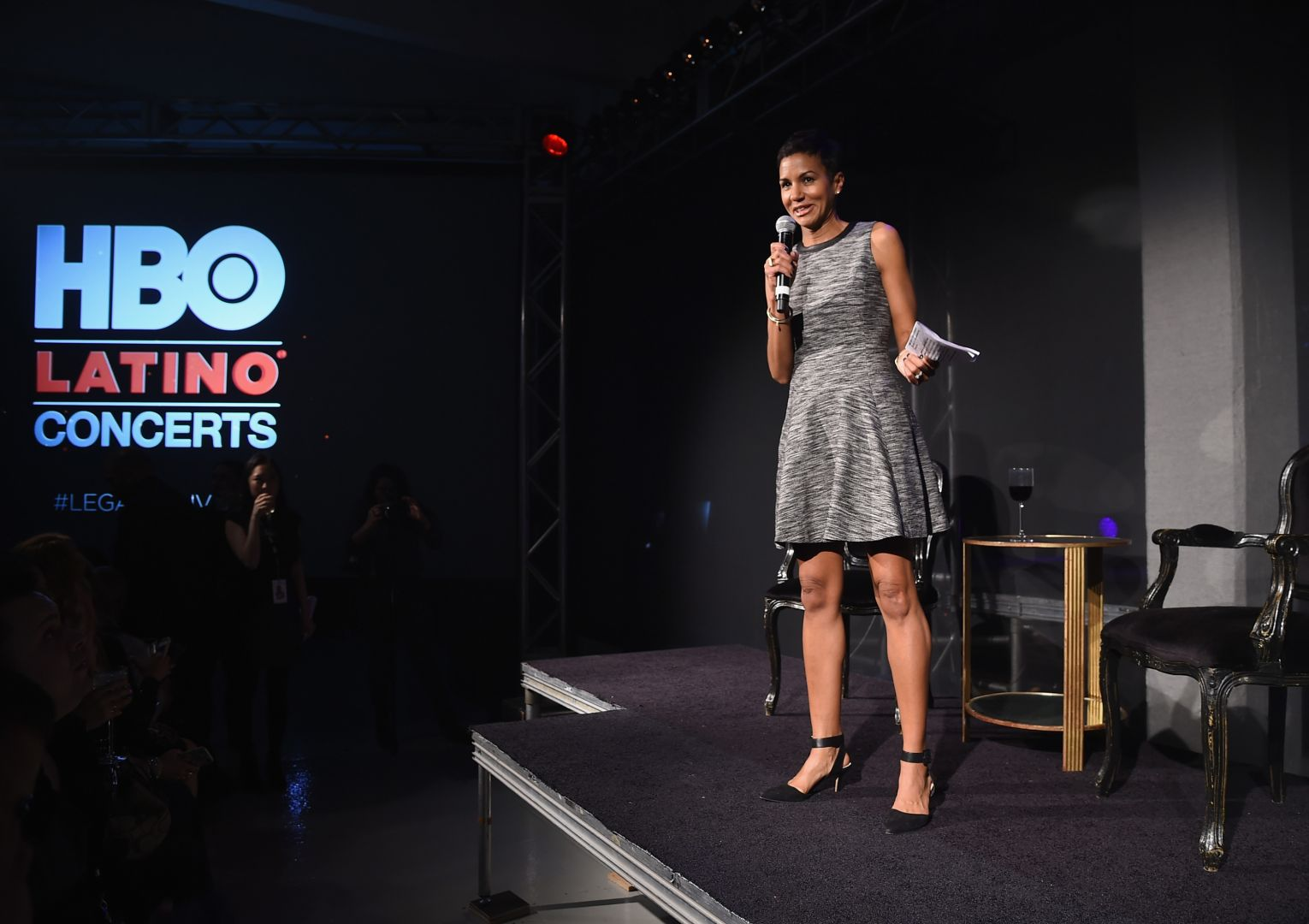 """HBO Latino multicultural marketing VP Jackie Gagne takes part in a Q&A during the HBO Latino red carpet premiere of the """"Camino Al Concierto and Legacy: De Lider a Leyenda"""" at Center 548 on April 7, 2015 in New York City. (Photo by Michael Loccisano/Getty Images for HBO)"""