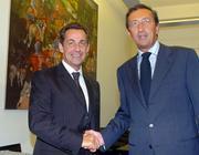 Sarkozy shakes hands with Italian neo-fascist Duce Fini