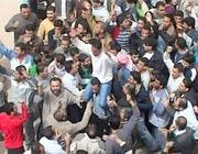Una manifestazione contro il regime in Siria (Ansa)