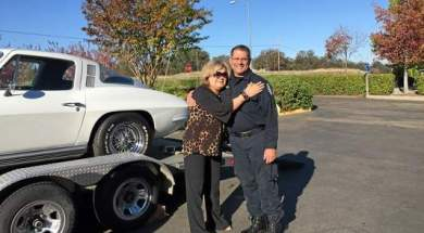 Modesto Fleming of Arizona hugs Red Bluff CHP Officer Dave Madrigal after he reunites her with her 1964 Chevrolet Corvette Stingray on Nov. 4 at the Main Street office. Photo Courtesy of Red Bluff CHP