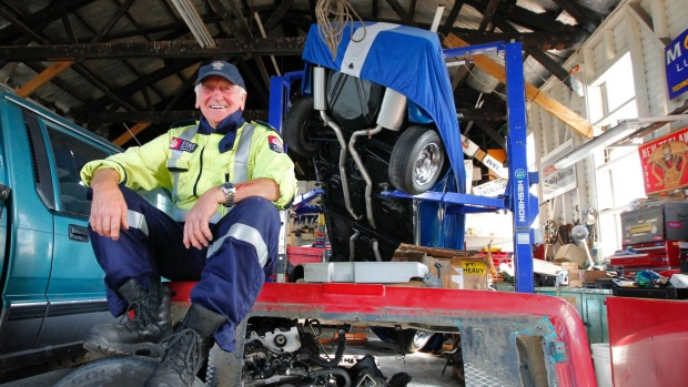 Kaikoura volunteer fire chief Ian Walker with his pride and joy a '72 Corvette which fell of a hoist in his workshop during the earthquake.