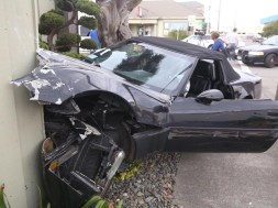 A black Corvette crashed into a Toyota pickup and careened into the fence of a Eureka Best Western Friday afternoon. | Photos by Andrew Goff.