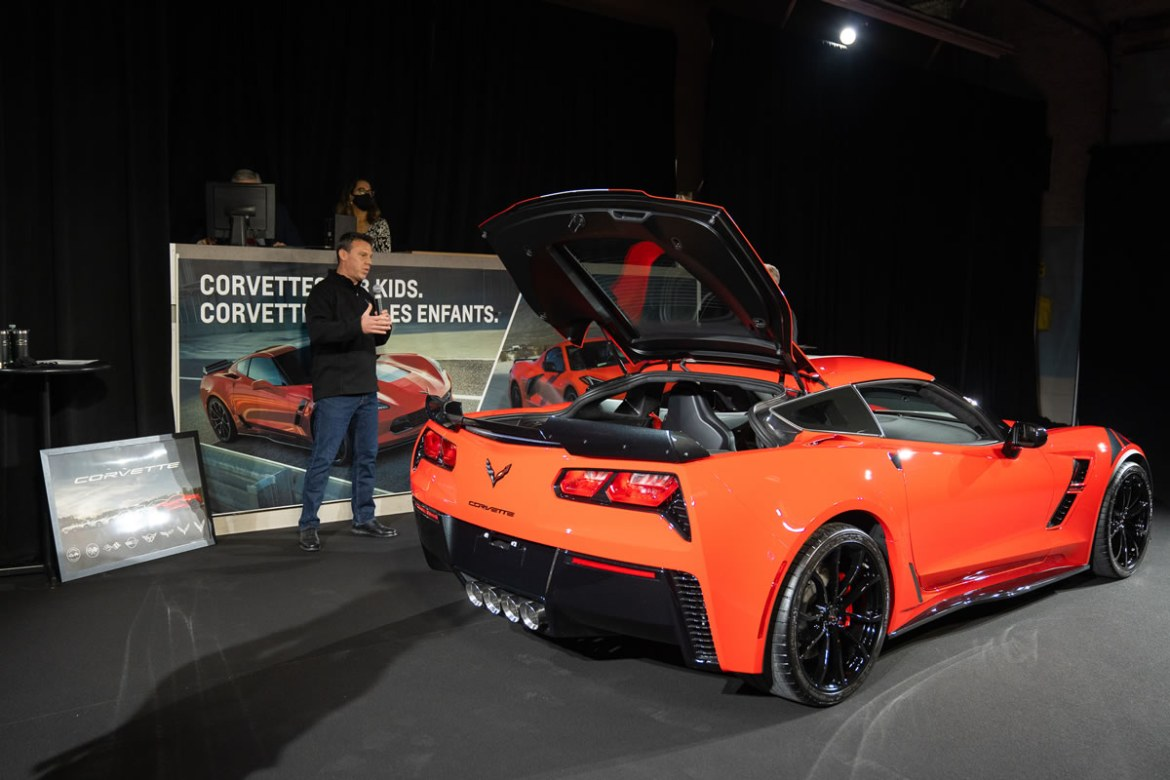 GM Canada President and Managing Director, Scott Bell auctions off the last 7th generation Chevrolet Corvette built for the Canadian market. Photo credit: Bavi Bas