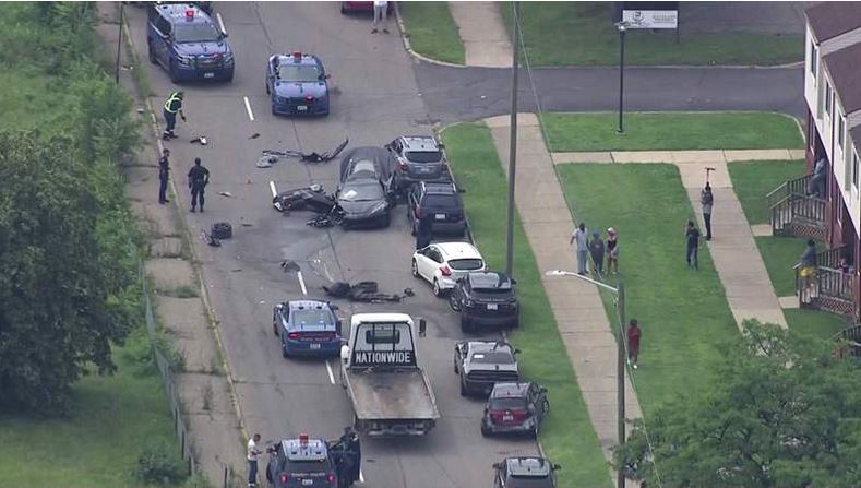 A black Corvette crashed in Detroit after a police chase on July 15, 2021. (WDIV)