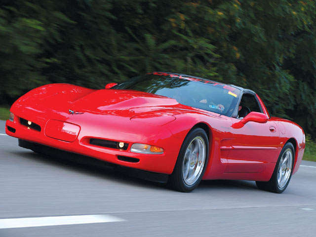 corp_0502_01_z+1997_chevrolet_torch_red_corvette+front_left_view