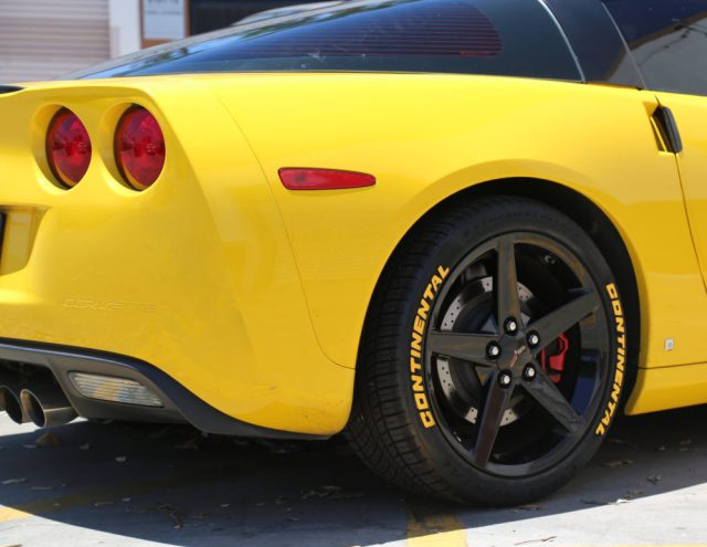 Yellow Continental Tire Stickers on C6 Corvette