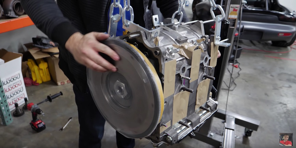 Madman Begins Mocking Up 13B Rotary Engine into Corvette Z06