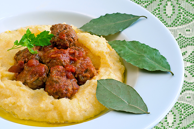 Traditional Italian Pork and beef meatballs served on polenta wi