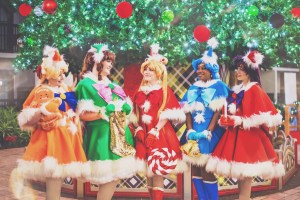 Cosmic Coterie posing in their holiday-themed Sailor Senshi costumes.
