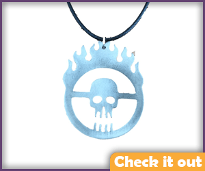 Immortan Joe Burning Skull Logo Necklace.