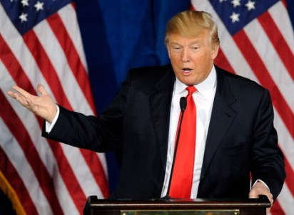 LAS VEGAS, NV - FEBRUARY 02:  Donald Trump endorses Republican presidential candidate, former Massachusetts Gov. Mitt Romney, for president during a news conference at the Trump International Hotel & Tower Las Vegas February 2, 2012 in Las Vegas, Nevada. Romney came in first in the Florida primary on January 31 and is looking ahead to Nevada's caucus on February 4.  (Photo by Ethan Miller/Getty Images)