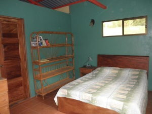 bedroom with plenty of light looks out to the mountains in1 BR home and lot for sale in san ramon costa rica