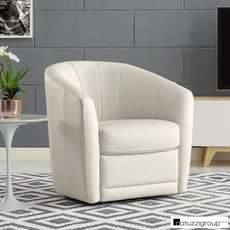 natuzzi swivel chair rocking with ottoman walmart cream leather accent costco uk