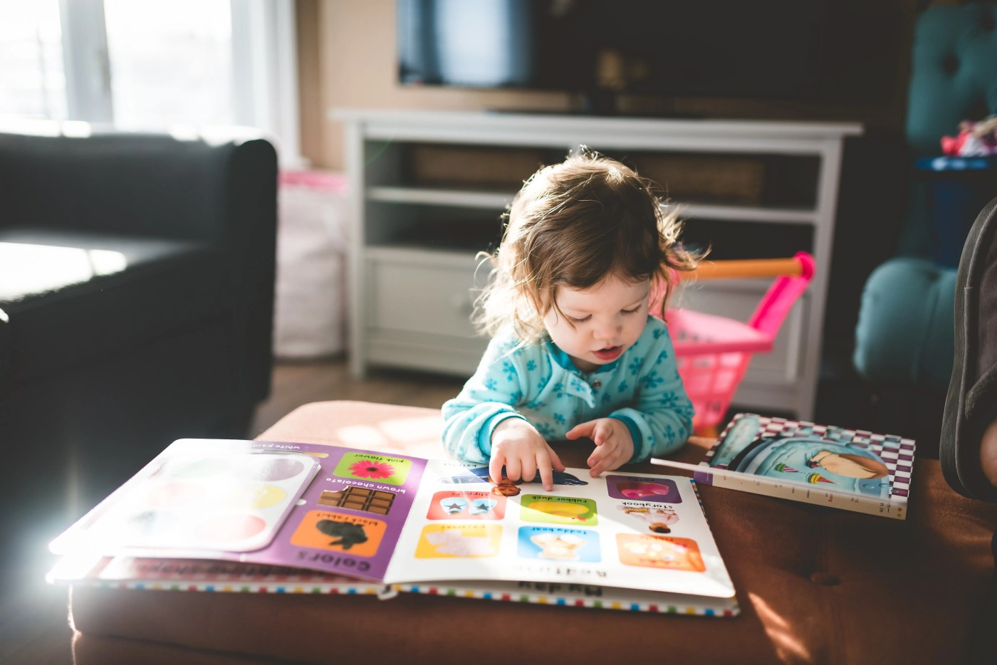 A child reading a book unassisted