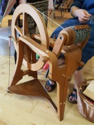 Emma at the Frank Herring Wheel for the Ulster Guild of Weavers, Spinners & Dyers