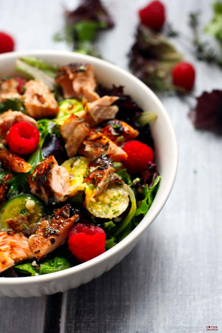 Salmon Salad Veggie Power Bowls with Raspberry and Balsamic Glaze. Finally, a salad this is packed with flavor, healthy fats, and amazing antioxidants! Zucchini, thyme, seasonal greens, grilled salmon, and raspberries make one POWERful and delicious combo.