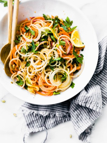 Light and Zesty Carrot Celeriac Spiralized Salad! This vegetablespiralized salad is simpleand healthy to make, not to mention delicious! A paleo, vegan, and whole 30 friendly veggie noodle salad option you can make under30 minutes.