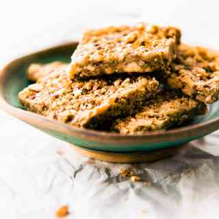 "Super easy 3 Step Paleo Baklava Flavored Bars! These vegan and paleo friendly ""baklava"" bars are packed full of sweet nutty flavor and healthy fats. Lower in carbs, sugar, and great for snacks or breakfast on the go. Totally tastes like that nutty rich dessert, but of course, WAY better for you! ENJOY! #paleo #lowcarb #bars #vegan"