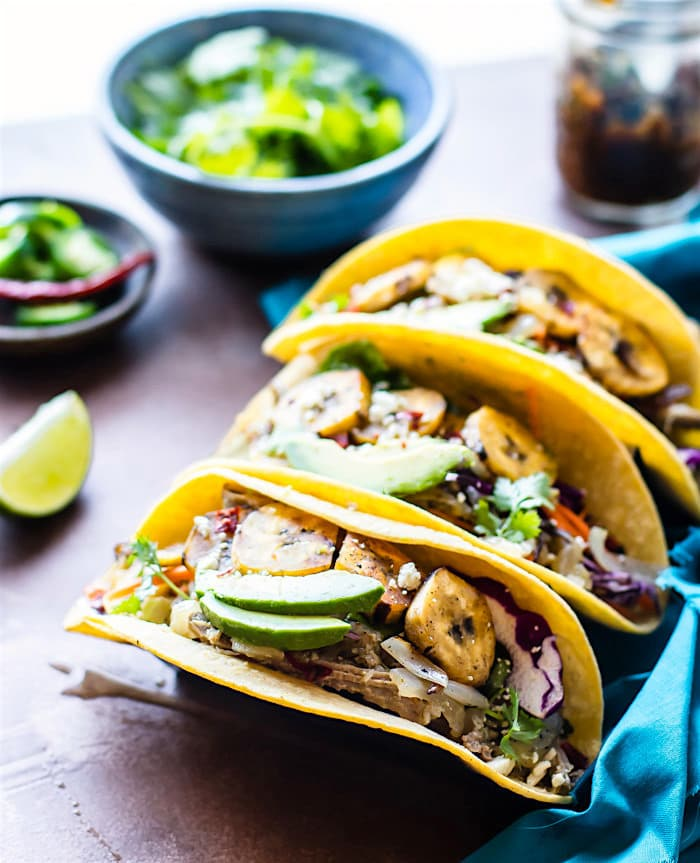 Delicious and Easy Crock Pot Cuban Pork Tacos with fried plantains! These healthy crock pot pork tacos are light, citrusy, and naturally sweetened with a plantain cabbage topping. Naturally gluten free and wholesome. Perfect for week night family meals or for make ahead multiple meals!