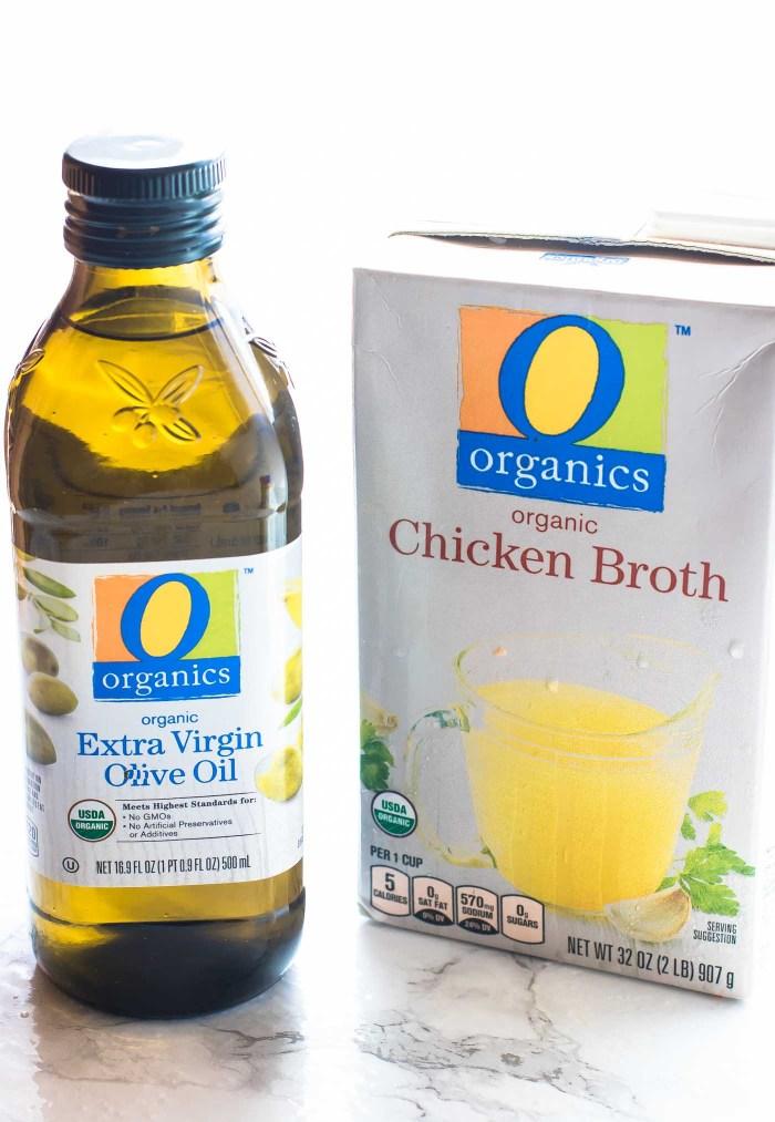 O Organics brand olive oil and chicken broth