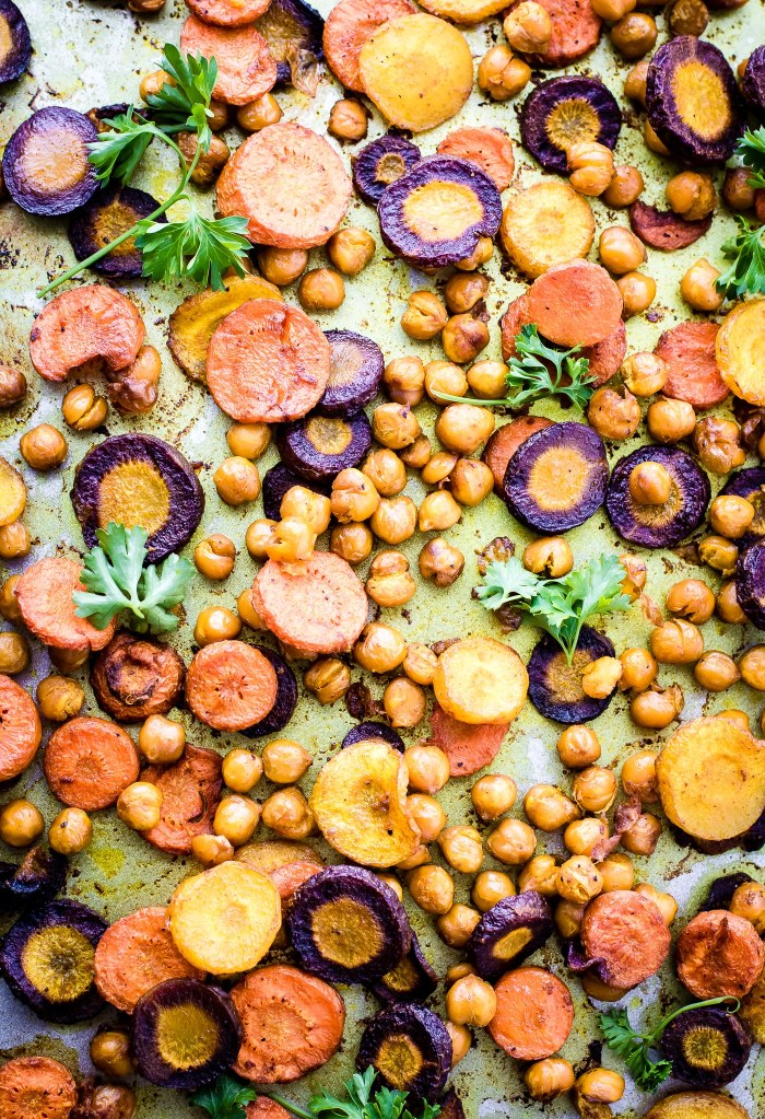 Turmeric Roasted Chickpea Carrot Salad with Apple Cider Tahini Dressing. A vegan salad with a golden glows! This Turmeric Roasted Chickpea Carrots Salad is simple to make yet wholesome and nourishing. A plant based main meal or a healthy gluten free side dish to pass around the table.