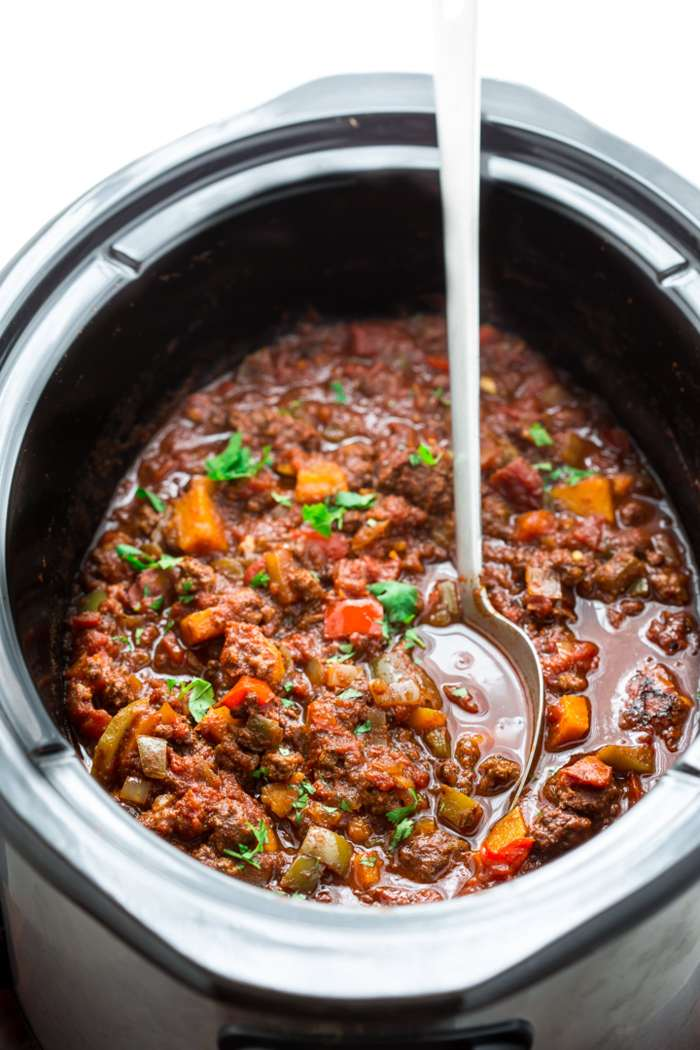 Paleo beef chili is not only easy to make in a slow cooker, but also full of flavor! Loaded with sweet potatoes, beef, spices, tomatoes, and more. It's whole 30 friendly, quick to prep, and pure comfort food. | CotterCrunch.com