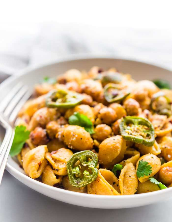 This Vegan Jalapeño Chickpea Mac and Cheese Pasta is gluten free, full of flavor, and ready in under 45 minutes. Made with a lentil and chickpea pasta, jalapeños, and Mexican spices. It's a healthy hearty plant based meal that can feed a family or dinner for two!