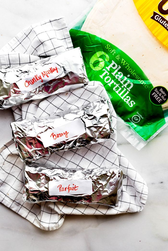 These sweet Gluten-Free breakfast wraps are the perfect grab and go breakfast! Portable, freezer friendly, and filled with wholesome simple ingredients! Literally a healthy breakfast bowl wrapped up to go; 3 ways! Healthy breakfast wraps that will satisfy your hunger on a busy schedule. www.cottercrunch.com #udisglutenfree