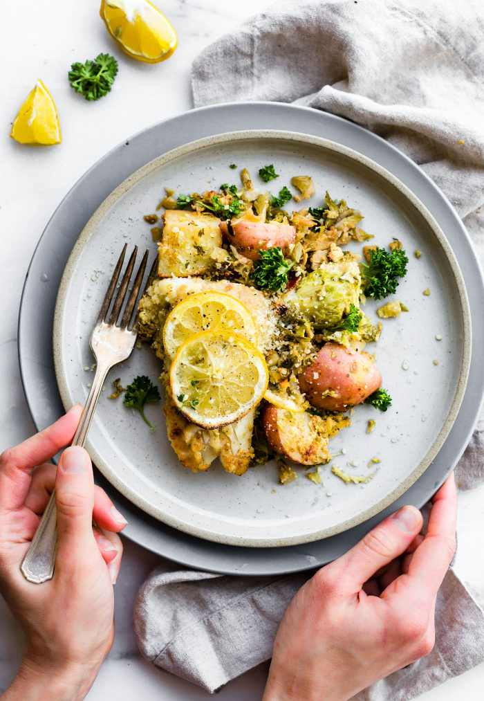 Honey mustard baked fish and vegetable recipe is a quick one pan meal ready in 30 minutes! A complete meal with healthy, light fish, then baked with wholesome vegetables.  Yes, even non fish lovers like it! And all it takes is just a few simple real food ingredients. Promise! Get a healthy dinner on the table in no time ya'll! Paleo friendly.