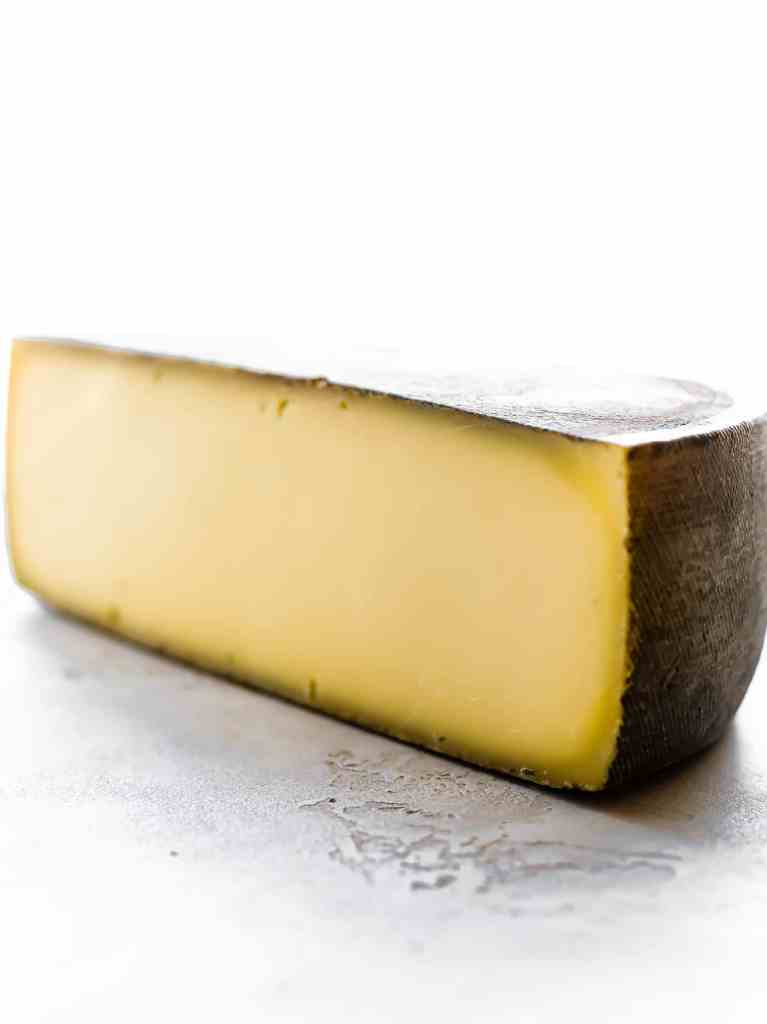 wedge of Kaltbach Le Cremeux cheese